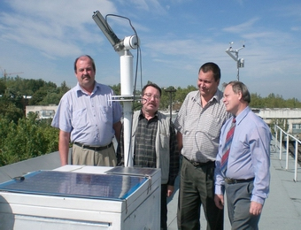 An image of the site manager Alexander Aculinin and Atmospheric Research Group colleagues Vladimir Smicov, Albert Policarpov and Vitali Graciov with the sun photometer.